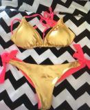 Costume rosa oro